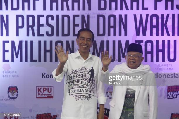Incumbent of Indonesian President Joko Widodo with his deputy candidate Ma'ruf Amin waved his hand after registering presidentia and vice president...