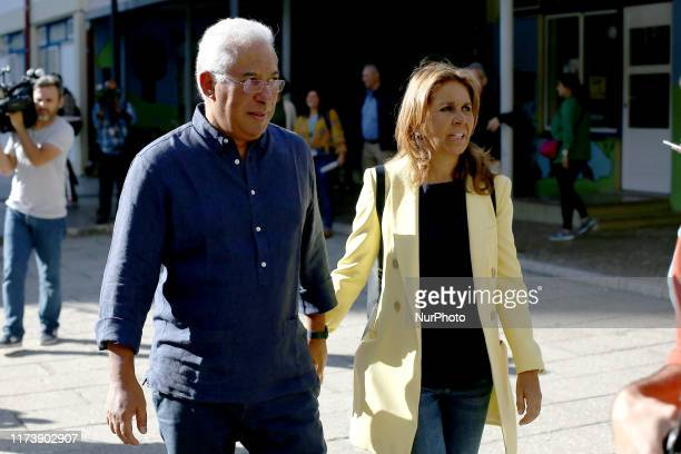 Incumbent Portuguese Prime Minister, leader and candidate of the Socialist Party Antonio Costa leaves with his wife Fernanda Tadeu after casted his...
