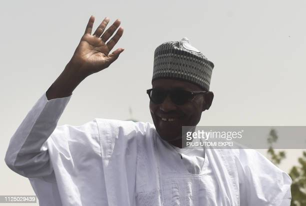 Incumbent President and candidate of the ruling All Progressives Congress party Mohammadu Buhari waves to supporters upon his arrival to his native...