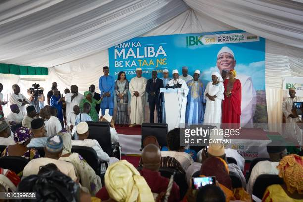 Incumbent president Ibrahim Boubacar Keita addresses supporters at his party headquarters in Bamako on August 3 a day after the announcement of the...