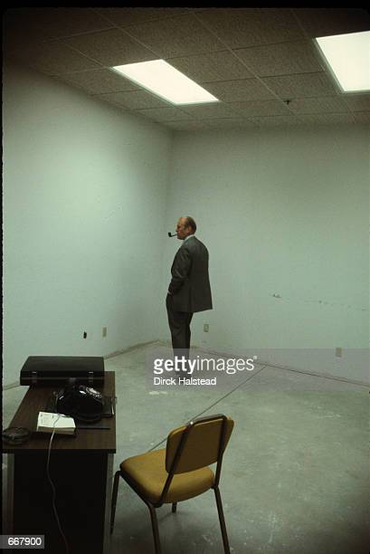 Incumbent presidential candidate Gerald Ford smokes a pipe and waits prior to an appearance September 25 1976