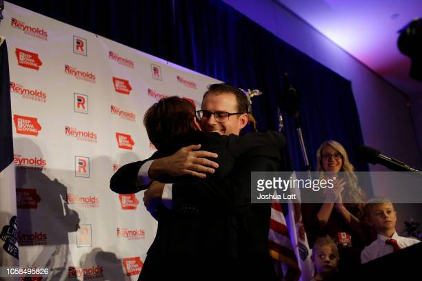 Incumbent Republican candidate for Iowa's Governor Kim Reynolds celebrates her reelection as she receives a hug from Lieutenant Governor Adam Gregg...