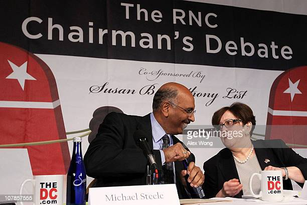 Incumbent Republican National Committee Chairman Michael Steele talks with former RNC official Maria Cino as they participate in a debate between...