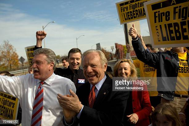 Incumbent Senator Joseph Lieberman applauds a supporter's good wishes while on his way to cast his vote on November 7 2006 in Hartford Connecticut...