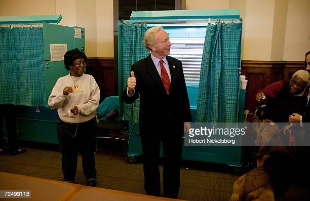 Incumbent Senator Joseph Lieberman gives a thumbs up sign to supporters after casting his vote on November 7 2006 in Hartford Connecticut Lieberman a...
