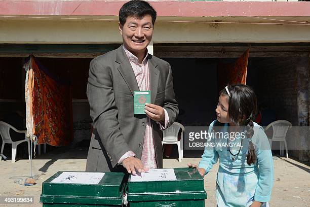 Incumbent Sikyong or Prime Minister of the Tibetan Government in Exile Lobsang Sangay casts his ballot during the preliminary round of Tibetan...