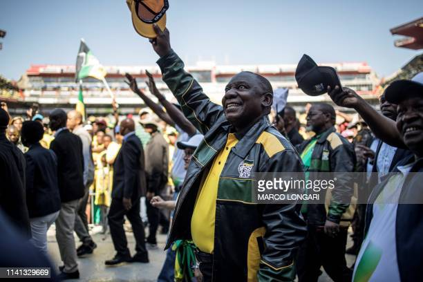 Incumbent South Africa's President and African National Congress party president Cyril Ramaphosa waves at supporters in Ellis Park stadium in...