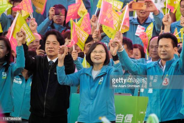 Incumbent Taiwanese President and candidate for the Democratic Progressive Party Tsai Ing-wen waves flags during an election campaign rally on...