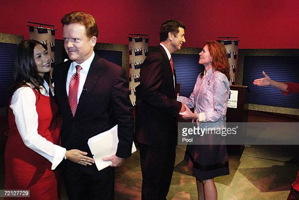 Incumbent U.S. Sen. George Allen and challenger, former Navy Secretary Jim Webb , are greeted by their wives Hong Webb and Susan Allen , after a...