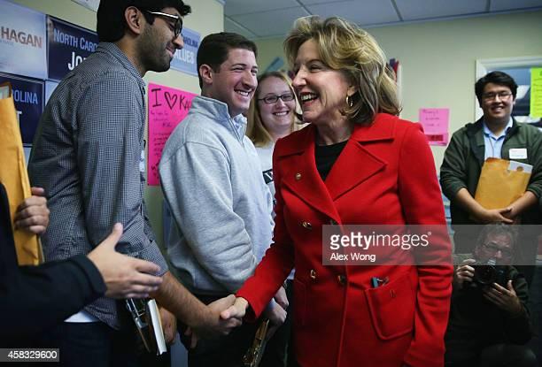 Incumbent US Sen Kay Hagan greets her campaign workers at a campaign office November 3 2014 in Cary North Carolina Senator Hagan is facing challenge...