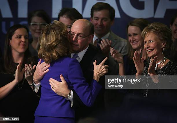 Incumbent US Sen Kay Hagan hugs her husband Chip as other family members look on after she conceded during her election night party November 4 2014...