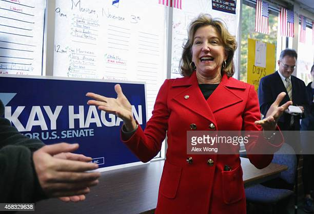 Incumbent US Sen Kay Hagan speaks to campaign workers at a campaign office November 3 2014 in Cary North Carolina Hagan is facing challenge from...