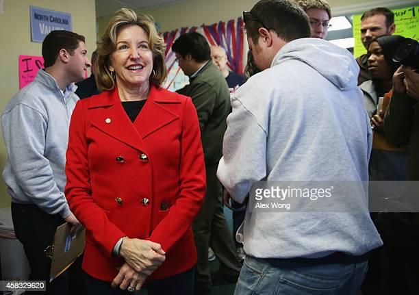 Incumbent US Sen Kay Hagan visits her campaign workers at a campaign office November 3 2014 in Cary North Carolina Senator Hagan is facing challenge...