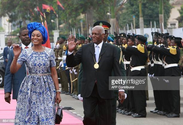 Incunbent Angolan President Jose Eduardo dos Santos waves as he arrives to attend the swearing in ceremony for the newly elected Angolan President...