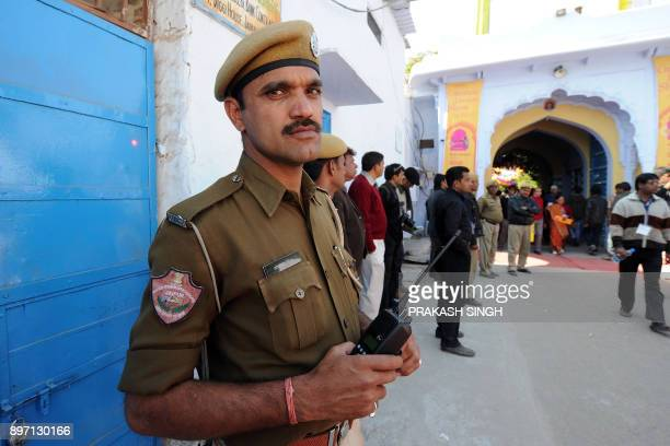 Indan police personnel stand guard at Diggi palace the venue for DSC Jaipur Literature Festival in Jaipur on January 24 2012 A video address by...