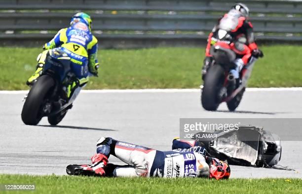 Inde Aspar Team Malaysian rider Hafiz Syahrin remains down after a crash with bike of Italtrans Racing Team Italian rider Enea Bastianini during the...