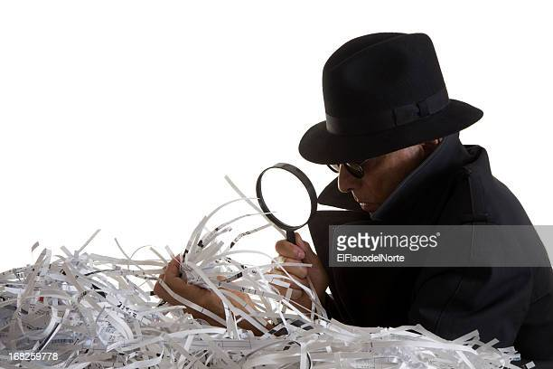 Indentity Thief sifts through shredded documents