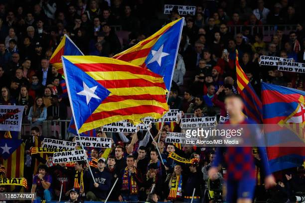 Independece flags and banners of ' Spain Sit and Talk' during the UEFA Champions League group F match between FC Barcelona and Slavia Praha at Camp...