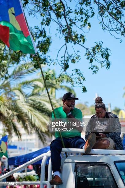 Independence activists sit on a pickup as they attend a symbolic day marking the taking of possession of New Caledonia by France on September 24 1953...