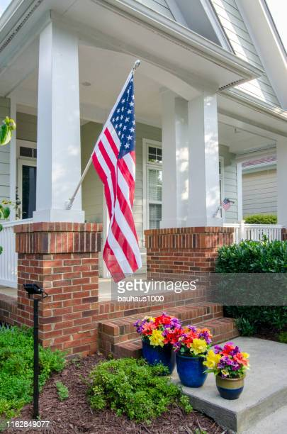 independence day celebration of patriotic homes and neighborhoods - labor day stock pictures, royalty-free photos & images
