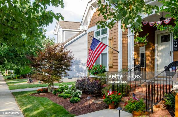 independence day celebration of patriotic homes and neighborhoods - flag day stock pictures, royalty-free photos & images
