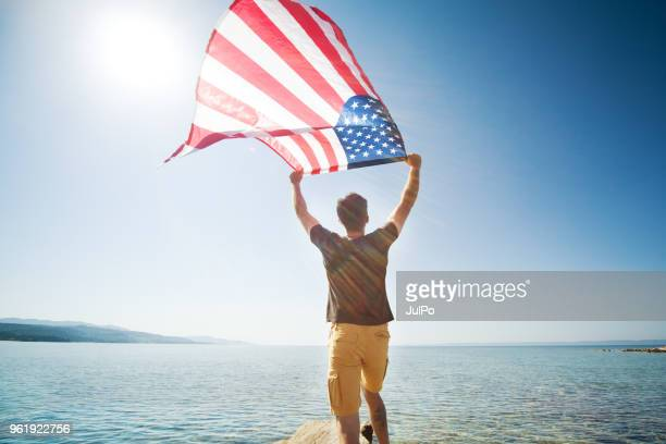 independence day - american flag ocean stock pictures, royalty-free photos & images