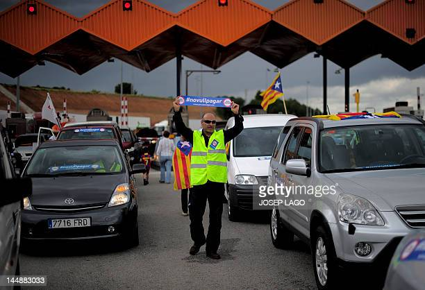 Independence demostrators shout slogans during a protest at a toll booth in Vilassar de Mar near Barcelona May 20 2012 People protested across...