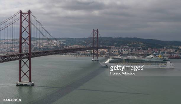 Independence of the Seas a Freedomclass cruise ship operated by the Royal Caribbean cruise line is about to sail under 25 de Abril bridge on the...