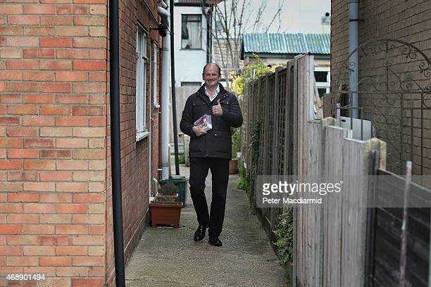 Independence Party candidate Douglas Carswell gives a thumbs up as he distributes leaflets to homes in the town centre on April 8 2015 in...