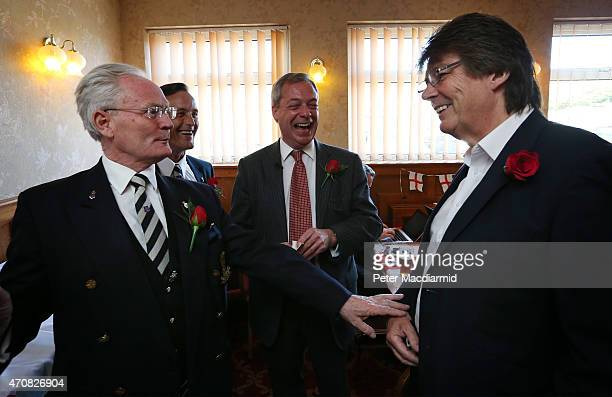 Independence Party leader Nigel Farage and former disc jockey Mike Read celebrate St George's Day with military veterans Blue Cooper and Robert...