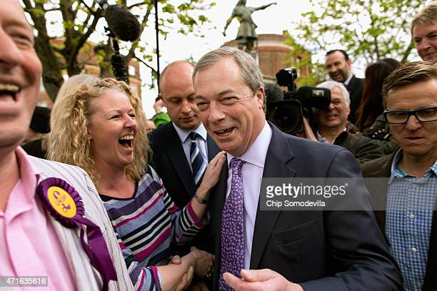 Independence Party leader Nigel Farage campaigns with UKIP parliamentary candidate Chris Adams underneath a statue of John Hampden in Market Square...