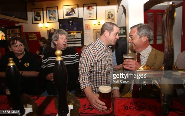 Independence Party leader Nigel Farage enjoys a pint with Paul Alvis, the landlord of Volunteer Rifleman's Arms, as he visits Bath to meet with party...