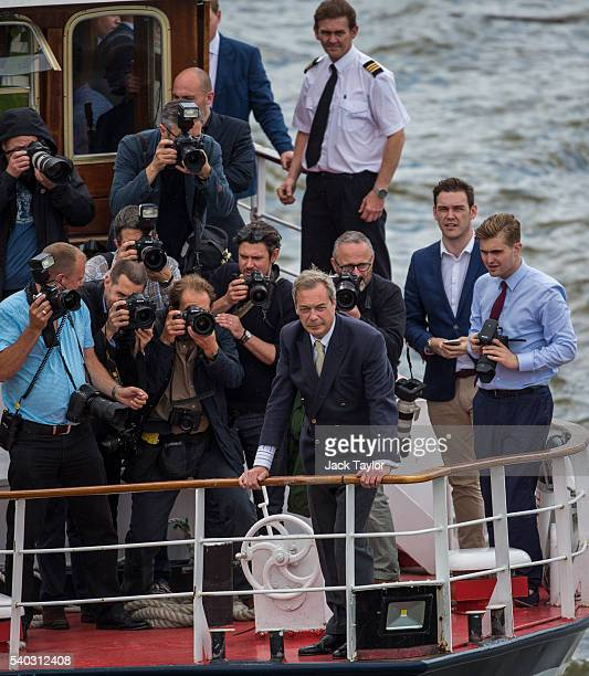 K Independence Party Leader Nigel Farage is pictured in front of photographers on a boat as he joins a flotilla along the Thames River on June 15...