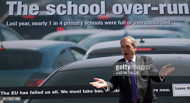 UK Independence Party leader Nigel Farage poses in front of a new campaign poster in ClactononSea eastern England on June 21 2016 Britain goes to the...