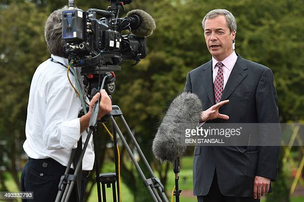 UK Independence Party leader Nigel Farage speaks during a television interview in Basildon in Essex east of London on May 23 as results continue to...