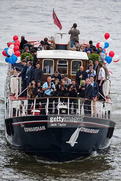 K Independence Party Leader Nigel Farage stands in front of photographers on a boat as he joins a flotilla along the Thames River on June 15 2016 in...
