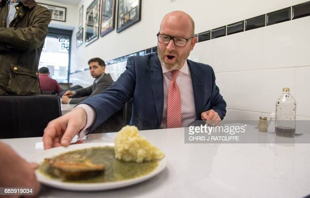 Independence Party leader Paul Nuttall eats pie and mash in a cafe, as he campaigns with local candidate Peter Harris , in Dagenham, east London, on...