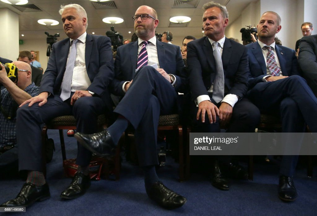 UK Independence Party (UKIP) leader Paul Nuttall (2L) listens to a speaker at the launch of the party's general election manifesto in central London on May 25, 2017. Britain goes to the polls on June 8 to elect a new parliament in a general election. / AFP PHOTO / Daniel LEAL