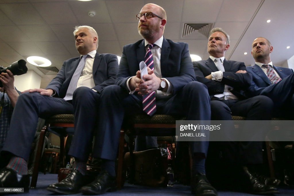 UK Independence Party (UKIP) leader Paul Nuttall (C) listens to a speaker at the launch of the party's general election manifesto in central London on May 25, 2017. Britain goes to the polls on June 8 to elect a new parliament in a general election. / AFP PHOTO / Daniel LEAL