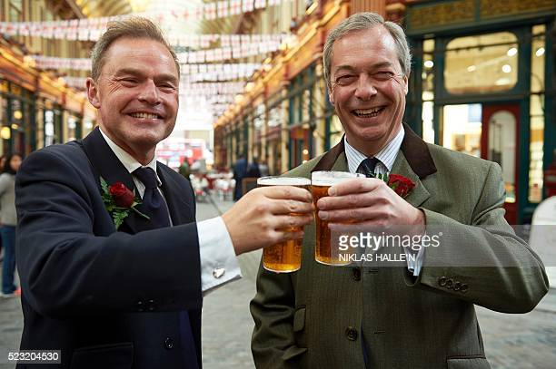 UK Independence Party London mayoral candidate Peter Whittle and UKIP leader Nigel Farage pose with pints of beer as they attend a St George's Day...