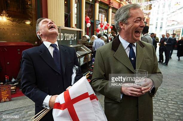 UK Independence Party London mayoral candidate Peter Whittle holding Saint George's Cross flags the flag of England and UKIP leader Nigel Farage...