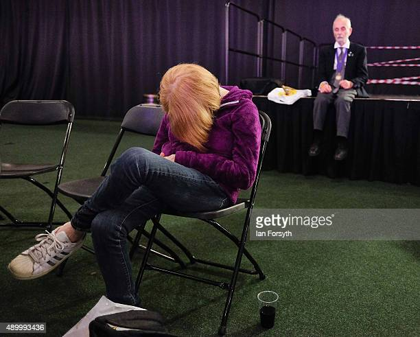 Independence Party supporter sleeps during speeches at the UKIP annual conference on September 25 2015 in Doncaster England After increasing their...