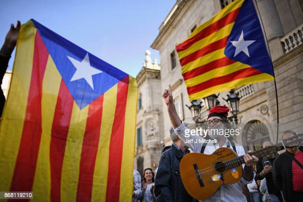 Independence supporters gather outside the Palau Catalan Regional Government Building as Catalonia returns to work following last week's decision by...