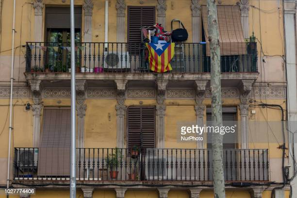 Independence symbols on the streets and buildings of Barcelona Spain on 1st September 2018 The estelada a flag used by citizens of the independence...