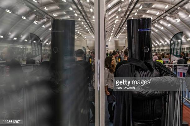 Independent candidate 'Lord Buckethead' jokes with members of the media as the count continues at the Uxbridge and South Ruislip Count on December...
