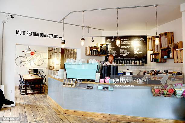 independent coffee shop, business owner working behind counter - coffee shop stock pictures, royalty-free photos & images