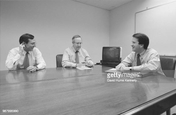 Independent Counsel Kenneth Starr center talks with Deputy Independent Counsel John Bates left and aide Brett Kavanaugh right and another colleague...