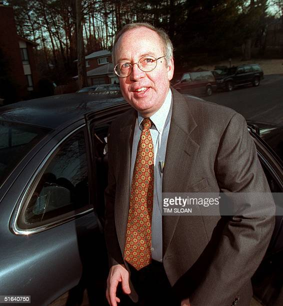 Independent Counsel Kenneth Starr pauses before getting into a car 10 February at his McClean VA home to leave for his Washington DC office Starr's...
