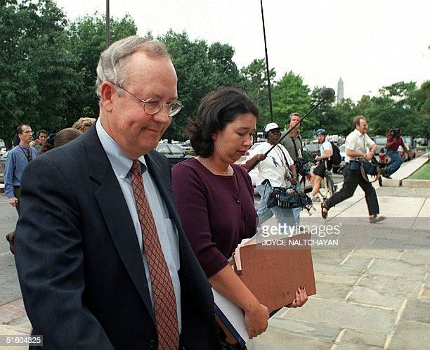 Independent Counsel Kenneth Starr walks into the US District Courthouse after speaking to reporters 30 June 1999 in Washington DC Starr briefed...