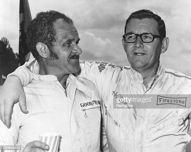 """Independent"""" drivers Wendell Scott and Jabe Thomas share a moment at a NASCAR Cup race."""